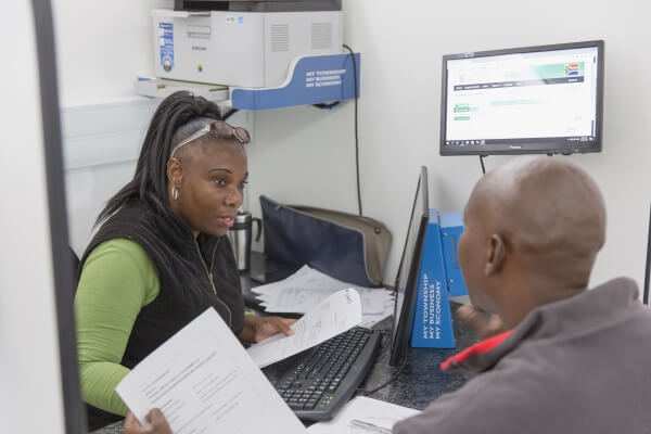 Woman helping a client on GDED mobile office