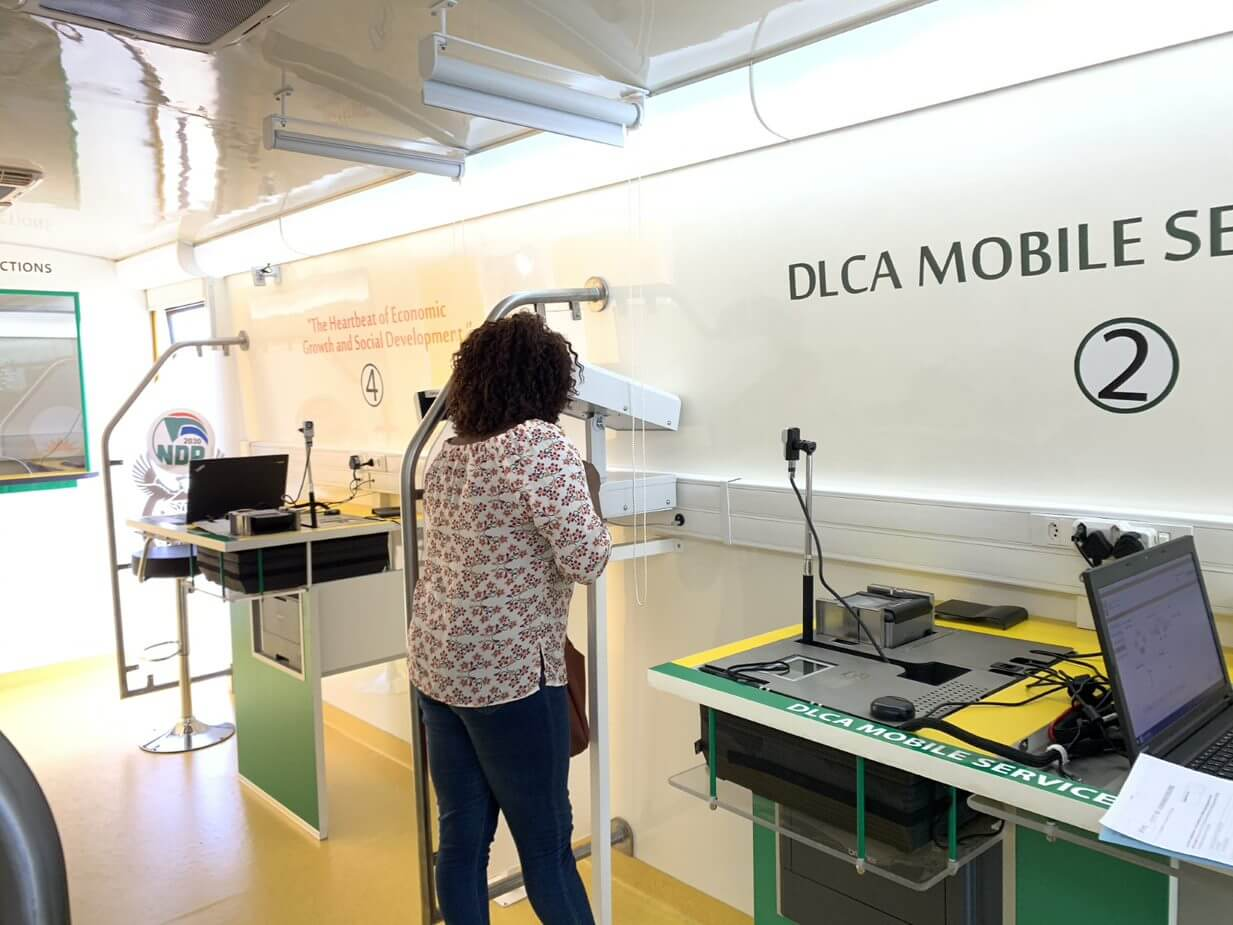 Lady doing eye test for license on DLCA mobile